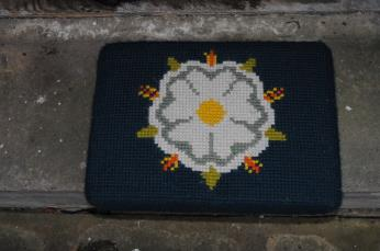 Kneeler - Donated By: J D Neil; Dedicated To: Mrs D Harrison; Worked By: Mrs Stoker;