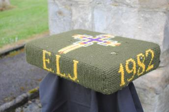 Kneeler - Donated By: A Loving Husband; Dedicated To: Edna L Jackson; Worked By: Florence Brammer;