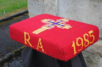 Kneeler - Donated By: Hilda Avery & Family; Dedicated To: Robert  Avery; Worked By: Florence Brammer;