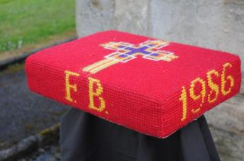 Kneeler - Donated By: Alice Hall; Dedicated To: Florence Brammer; Worked By: Alice Hall;