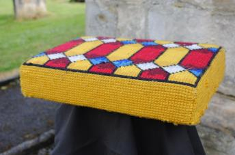 Kneeler - Donated By: Family and Dalton Mothers Union; Dedicated To: Edna Jackson; Worked By: Florence Brammer;