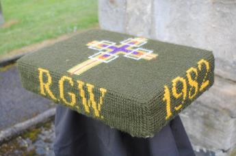 Kneeler - Donated By: Wife Maggie; Dedicated To: Robert G Wilson; Worked By: Margaret Lauder;