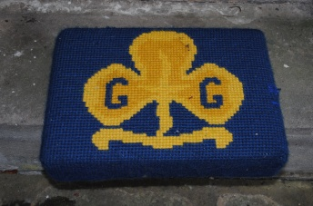 Kneeler - Donated By: 1st Dalton Brownies; Dedicated To: Mrs Quinn; Worked By: Edith Heron;